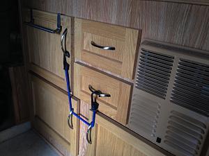 Can cupboard bungee.jpg